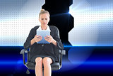 Composite image of front view of concentrated chic businesswoman using her tablet
