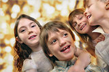holiday portrait of happy children against bright golden backgro