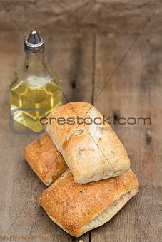 Olive bread rollis in rustic kitchen setting with utensils