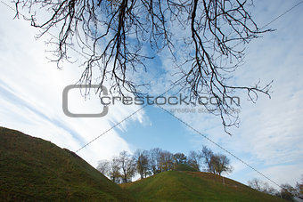 Autumn landscape with a hill and clouds