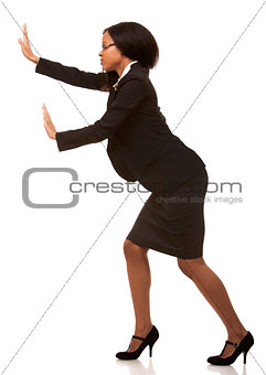business woman pushing invisible object