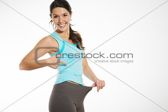 Athletic woman showing off her weight loss