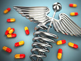 Pills and caduceus pharmacy symbol on white isolated background.