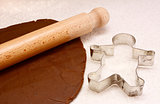 Gingerbread dough, rolling pin and cookie cutter