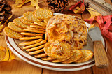 Cheddar cheese ball with crackers