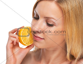 Portrait of teenage girl holding lemon