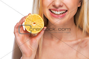 Closeup on teenage girl holding lemon