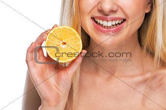 Closeup on teenage girl holding lemon