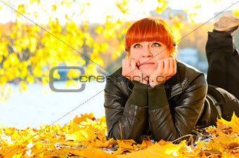 beautiful girl with red hair in  park