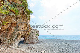 grotto in the rock on the sea beach