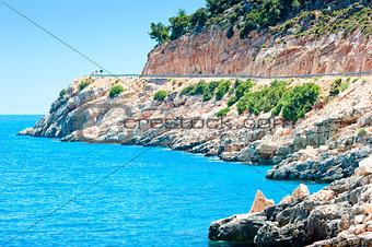 rocky landscape and a blue calm sea