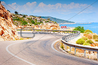 road in the mountains turns sharply over the mountain