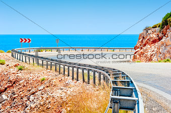 Sea and mountain highway fenced striker