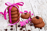 stack of chocolate cookies tied with pink ribbon and coffee bean