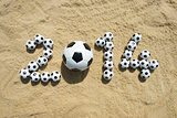 Sporty 2014 Message in Sand with Football Soccer Balls