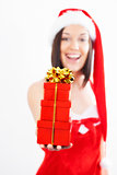 Beautiful young woman with Christmas present