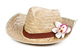 straw hat with a flower orchid