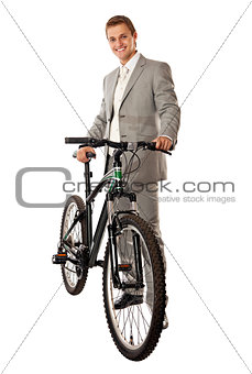 Attractive young man in a suit standing next to a bike