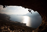 Silhouette of a rock climber at sunset. Kalymnos Island, Greece