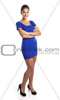 Beautiful young girl standing with arms folded