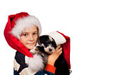 Boy and dog in Santa hat at Christmas