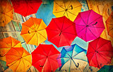 Colorful umbrellas on grunge paper
