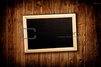 Blan message board on wooden background