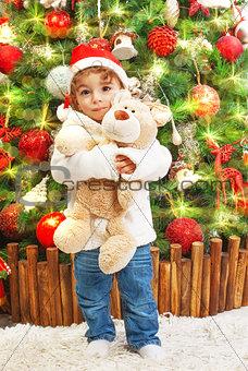 Little boy with teddy bear