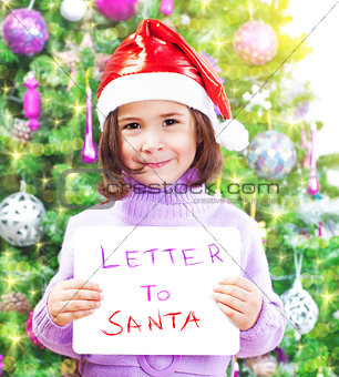 Little girl with letter to Santa Claus