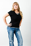 Young woman in jeans with long hair