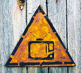 TV Set Icon on Rusty Warning Sign.