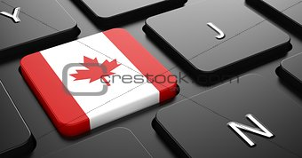 Canada - Flag on Button of Black Keyboard.