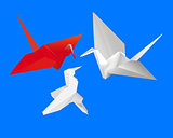 three Japanese paper cranes