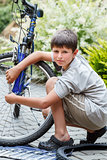 Teenager repairing his bike, changing broken tire