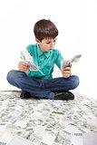 boy sitting on money, money concept