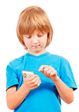 Boy Sending Text Message on Mobile Phone
