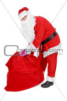 Santa reaches for a gift
