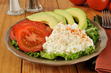 Cottage cheese with tomato and avocado