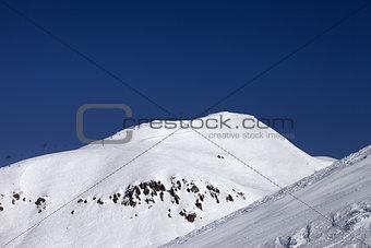 Ski slope and ropeway at nice winter day