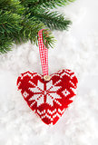 Knitted heart on the snow