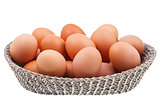 twenty fresh chicken eggs in wicker basket