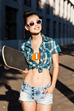 beautiful lady with skateboard in the city