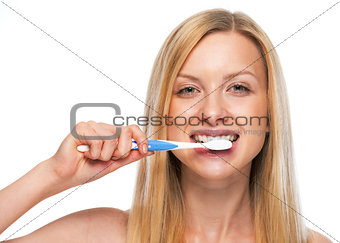 Portrait of teenage girl brushing teeth