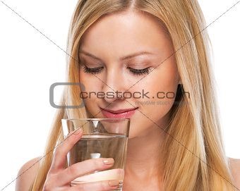 Portrait of happy teenage girl with cup of water