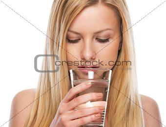 Portrait of teenage girl drinking water