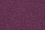 Background made of purple decorative sand.