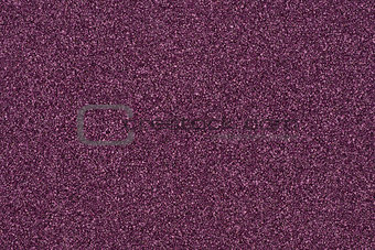 Background made of purple decorative sand.
