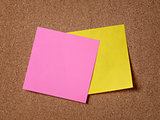 two reminder sticky notes on cork board