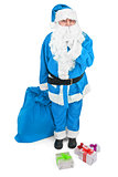 Funny blue Santa asks to be quiet