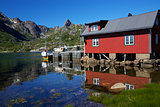 Fishing hut reflecting in fjord